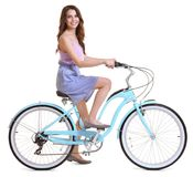 Beautiful young woman riding bicycle. On white background royalty free stock image