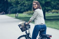 Beautiful young woman on bike in park Stock Photos