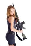 Beautiful young woman with rifle. Beautiful sexy blond woman holding army rifle Royalty Free Stock Images
