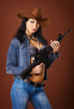 Beautiful young woman with a rifle Stock Photo