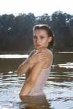 Beautiful young woman in the river Royalty Free Stock Image