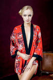 Beautiful young woman in robe. Slim body of the beautiful woman with blond hair. beautiful sexy blond woman with big breast. Big boobs Royalty Free Stock Photography