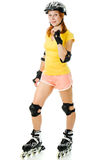 Beautiful young woman on roller skates Stock Images
