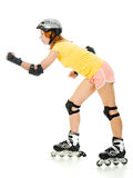 Beautiful young woman on roller skates Royalty Free Stock Images