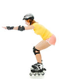 Beautiful young woman on roller skates Stock Photo