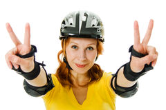 Beautiful young woman on roller skates Royalty Free Stock Image