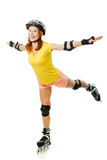 Beautiful young woman on roller skates Royalty Free Stock Photography