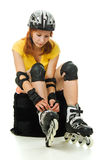 Beautiful young woman on roller skates Stock Image