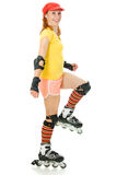 Beautiful young woman on roller skates Royalty Free Stock Photo
