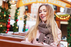 Beautiful young woman on a rollercoaster Stock Images