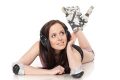 The beautiful young woman in rollerskates. Royalty Free Stock Photo