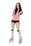 The beautiful young woman in rollerskates. Stock Photos