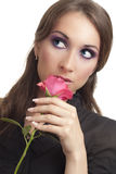 Beautiful young woman with rose Stock Images