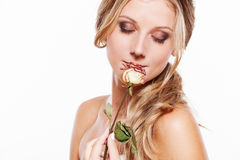 Beautiful young woman with rose Royalty Free Stock Image