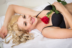 Beautiful young woman with a rose Stock Photos