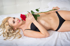 Beautiful young woman with a rose Stock Images