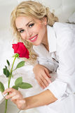 Beautiful young woman with a rose Stock Photo