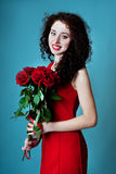 Beautiful young woman with rose flowers Royalty Free Stock Photos