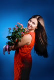 Beautiful young woman with rose flowers Royalty Free Stock Images