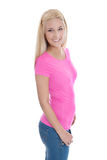 Beautiful young woman in rose shirt and blue jeans isolated. Royalty Free Stock Image