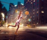 Woman run with huge lollipop in her hand Stock Image