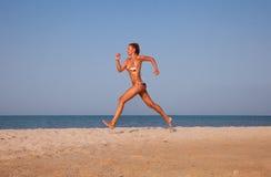 Beautiful young woman running Stock Photo