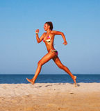 Beautiful young woman running Royalty Free Stock Photo