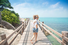 Beautiful young woman running  along the bridge against the back Royalty Free Stock Photo