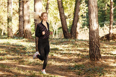 Beautiful young woman running Stock Images