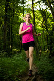 Beautiful young woman runs on forest  path Stock Photo
