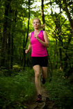 Beautiful young woman runs on forest  path Stock Photography