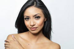 Beautiful young woman`s face and bare skin Royalty Free Stock Image