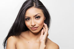Beautiful young woman`s face and bare skin Stock Images