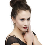 Beautiful young woman's face with hair in bun Royalty Free Stock Images
