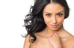 Beautiful Young Woman`s Face With Gorgeous Curly Black Hair Royalty Free Stock Images