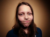 Beautiful young woman with sad face. Stock Photography