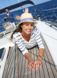 Beautiful young woman on a sailing boat Stock Images