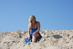 Beautiful young woman on a sand-pit Stock Image