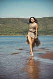 Beautiful young woman on a sandy beach Royalty Free Stock Photography