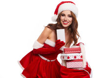 Beautiful young woman in Santa Claus clothes . Royalty Free Stock Photos