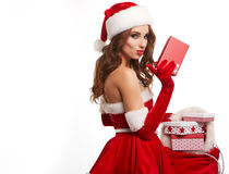 Beautiful young woman in Santa Claus clothes . Stock Photo