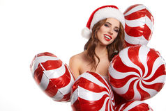 Beautiful young woman in Santa Claus clothes . Stock Images