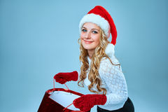 Beautiful young woman in Santa Claus clothes Stock Photography