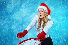 Beautiful young woman in Santa Claus clothes Royalty Free Stock Images