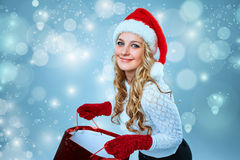 Beautiful young woman in Santa Claus clothes Stock Photo