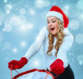 Beautiful young woman in Santa Claus clothes Stock Photos