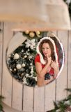 Beautiful young woman in Santa Claus clothes looking in the mirror Royalty Free Stock Photo