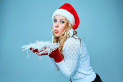 Beautiful young woman in Santa Claus clothes with Stock Photo