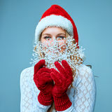 Beautiful young woman in Santa Claus clothes with Stock Photos