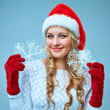 Beautiful young woman in Santa Claus clothes with Royalty Free Stock Image